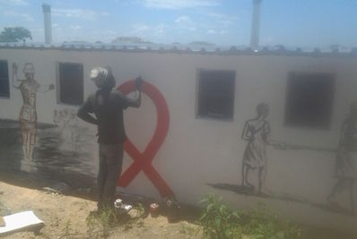 painting the toilet block at ngozi dump site